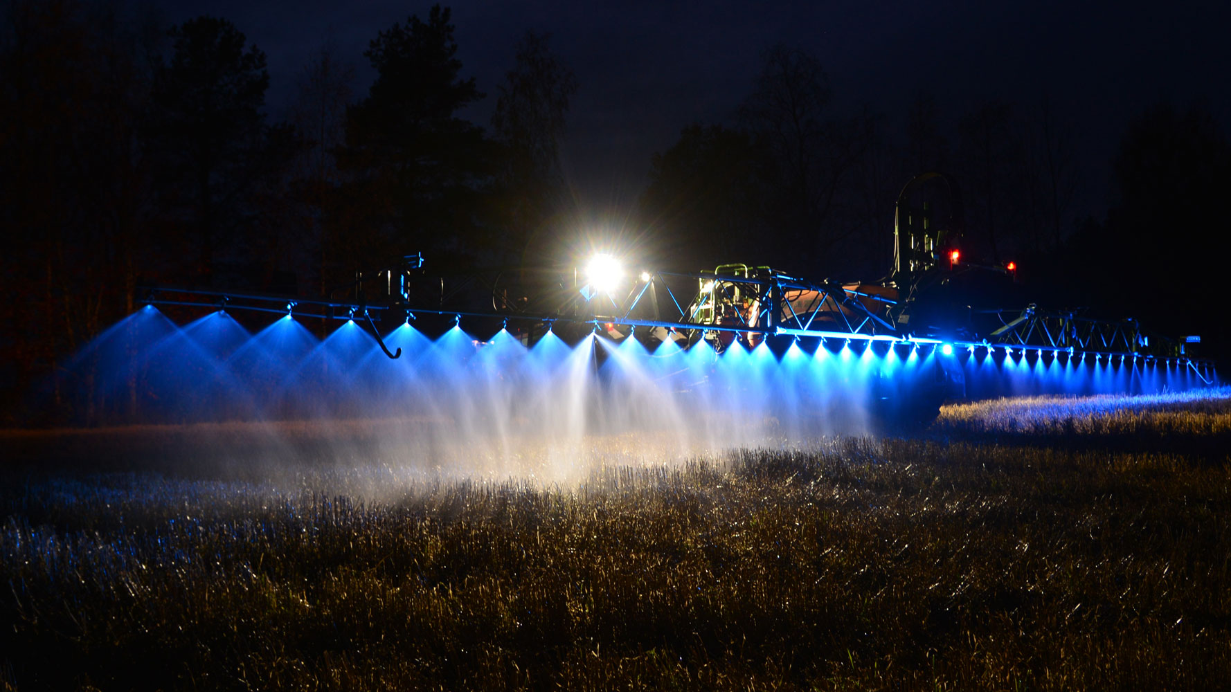 Blue LED crop sprayer boom light mounted