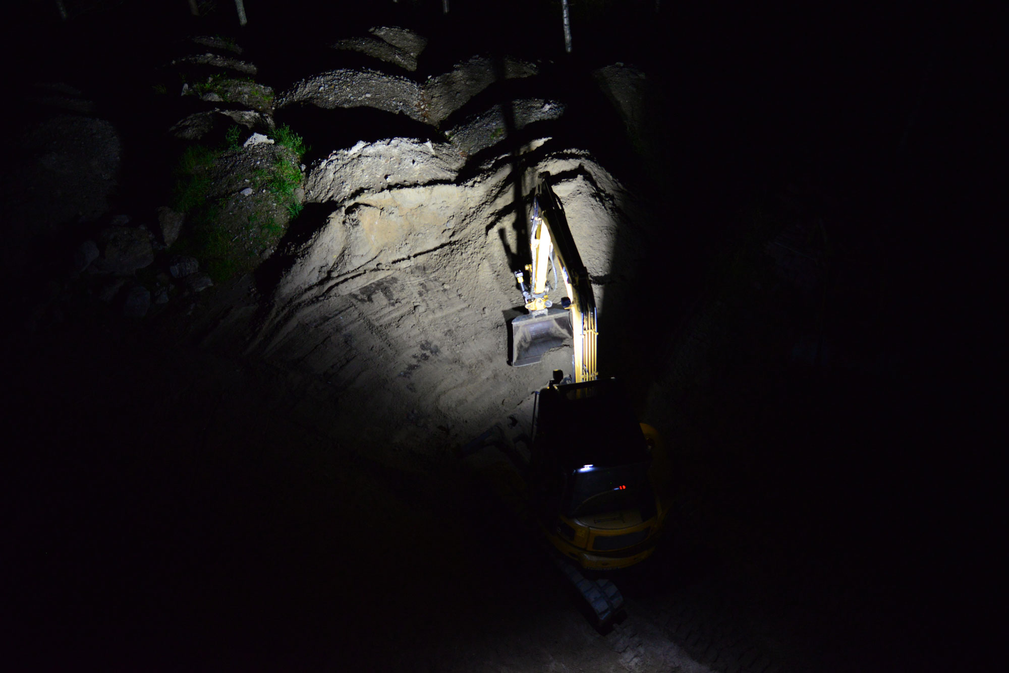 Small yellow excavator digging with Nordic Lights LED Work Lights
